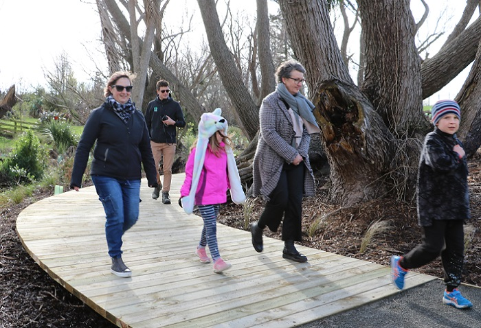 A mother, grandmother and two children walk the new walkway