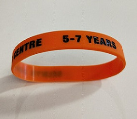 An image of the orange 5-7 years wrist band