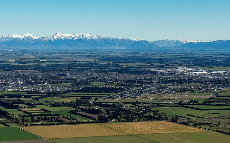An aerial image of the plains looking towards the Southern Alps