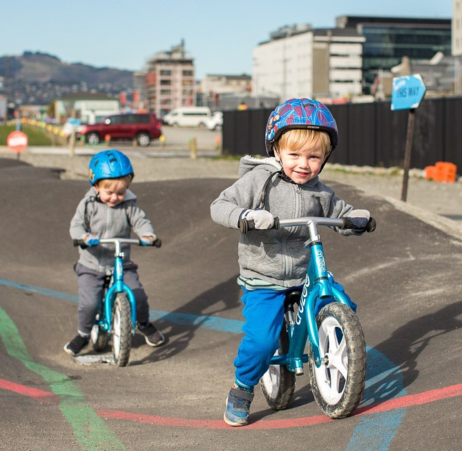 Two children using a pump track in central Christchurch