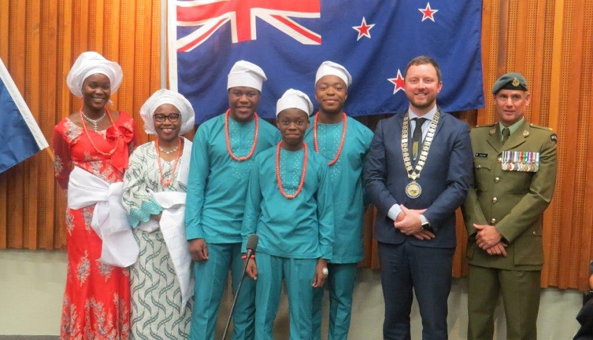The Iposu family in traditional Nigerian dress with Mayor Sam Broughton
