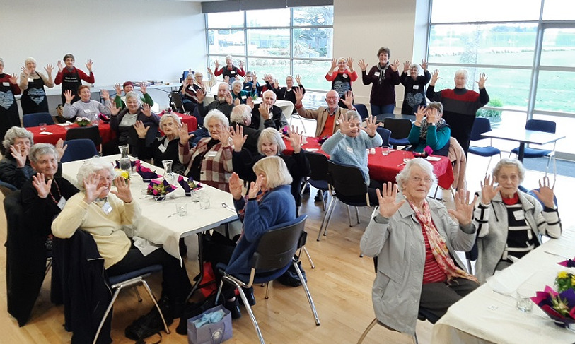 The members of the Springs Day Club at their birthday celebration, all holding up 10 fingers