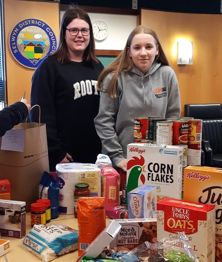 Two girls and groceries - Food Drive