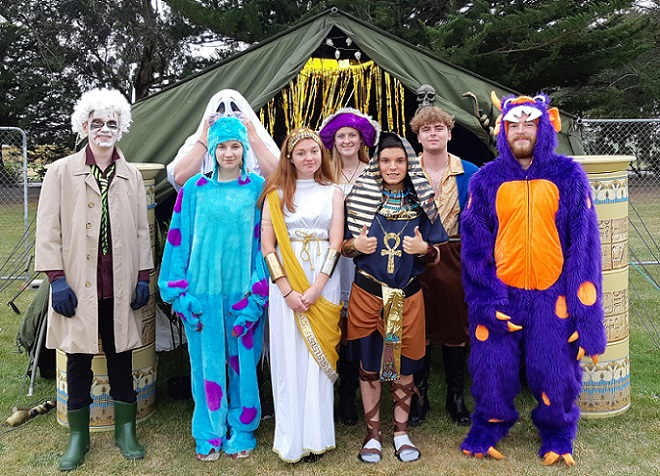 A group of teenagers in Halloween costumes