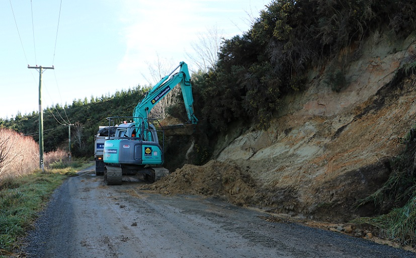 A digger clearing a slip on Malvern Hills Road