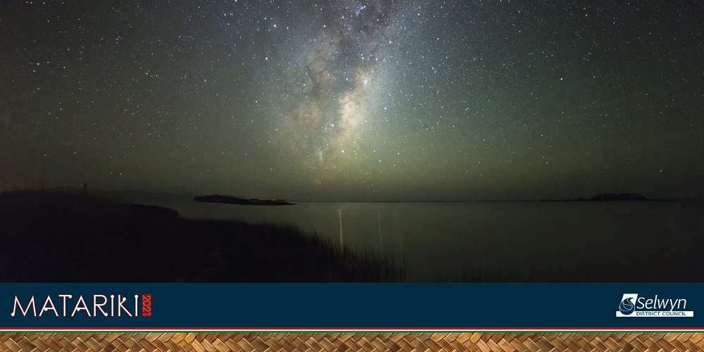 A sky full of stars over a lake with the Council Matariki logo in the corner
