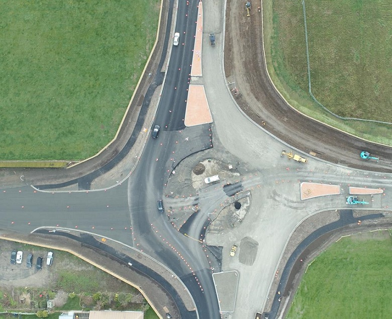 An aerial view of the partially completed roundabout showing the road layout and tarmac completed on one side