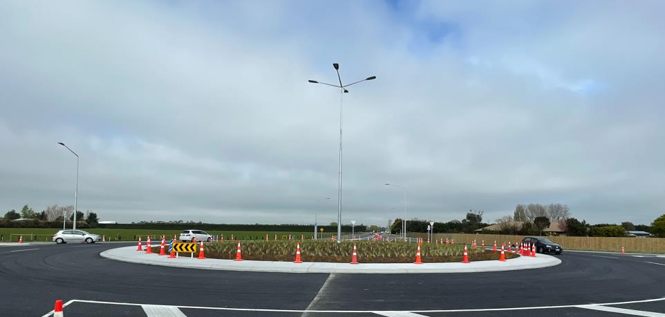 The new roundabout with cars going round it