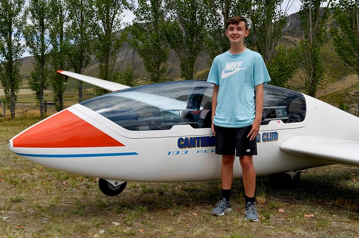 14-year-old Jack Clapham from Rolleston stands next to the Canterbury Youth Glide glider