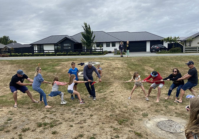 A tug of war at the annual Friends of the Woods subdivision Christmas picnic