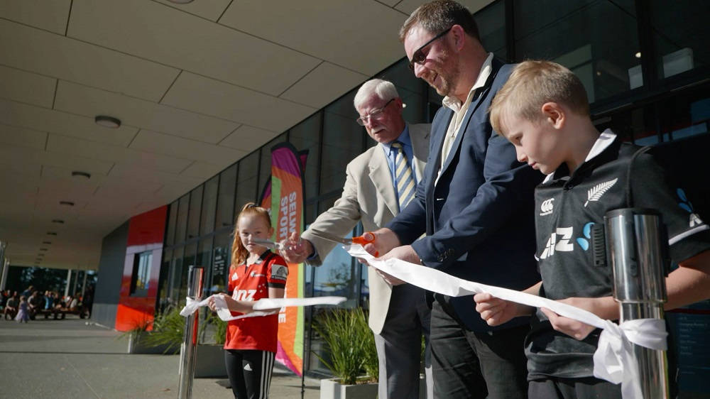 Sir Richard Hadlee, Mayor Sam Broughton and two children cut the ribbon for the opening of the Selwyn Sports Centre