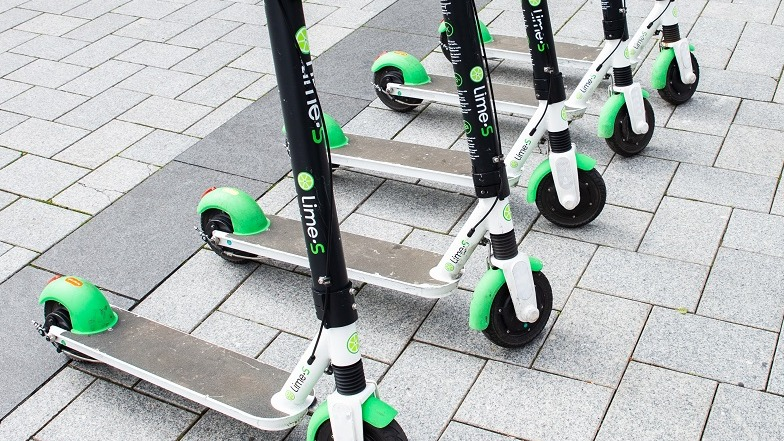 A row of parked Lime Scooters in Christchurch
