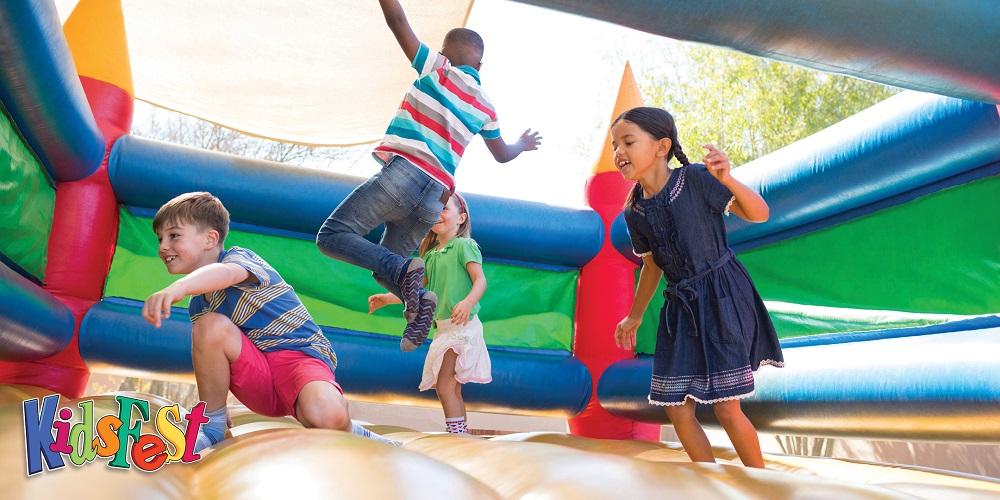 Children bouncing on a bouncy castle