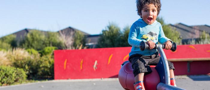 A little boy on playground equipment