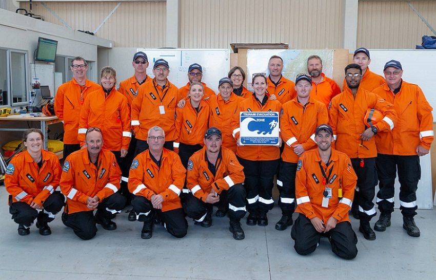 Group photo of the Selwyn Response Team in their high visibility orange jackets
