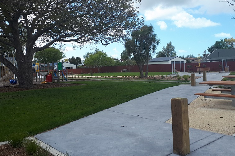 A picture of the upgraded Southbridge reserve showing picnic tables, paths and lawns