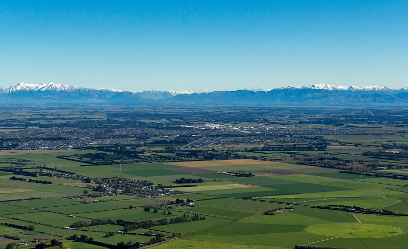 Landscape over the plains with southern alps in the background