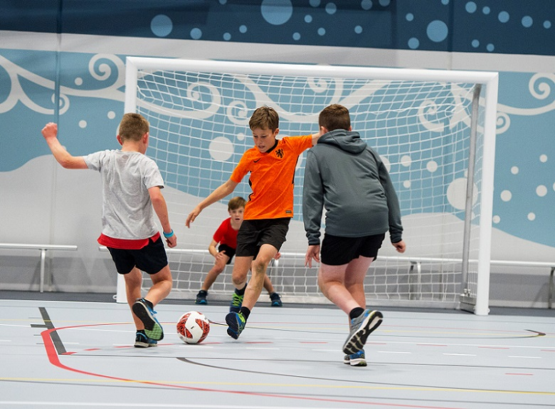 Children playing indoor football at Selwyn Sports Centre