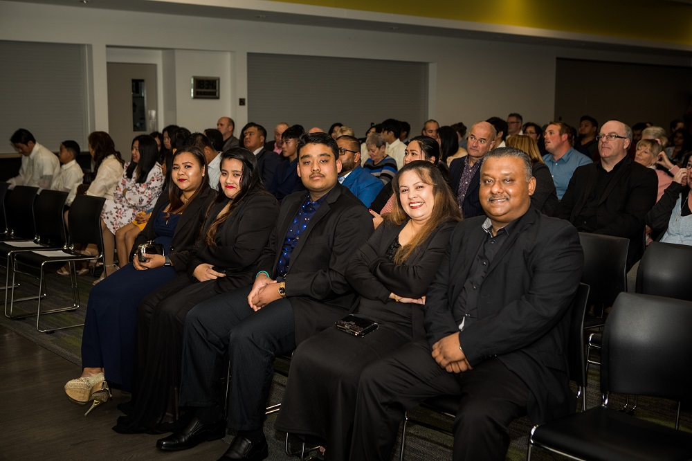 A group of new citizens and guests at the citizenship ceremony