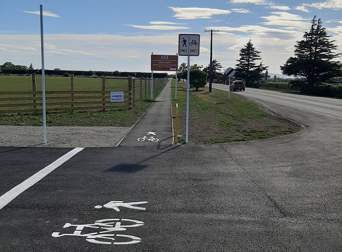 Image of the Leeston Doyleston cycleway showing the fresh asphalt and signage
