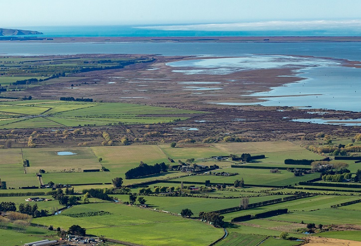 An aerial view of the edge of Lake Ellesmere and the coast