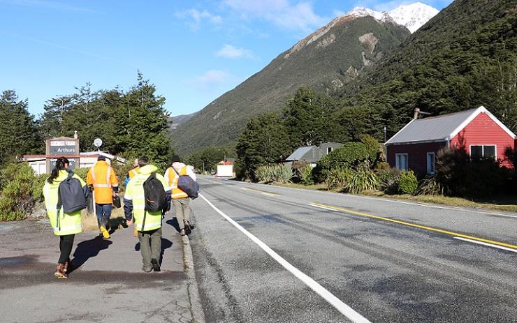 Civil Defence response team in high vis jackets walking through Arthur's Pass Village