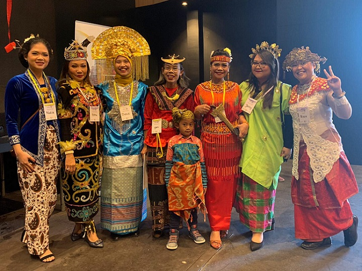 Line of Indonesian women in cultural dress preparing for CultureFest