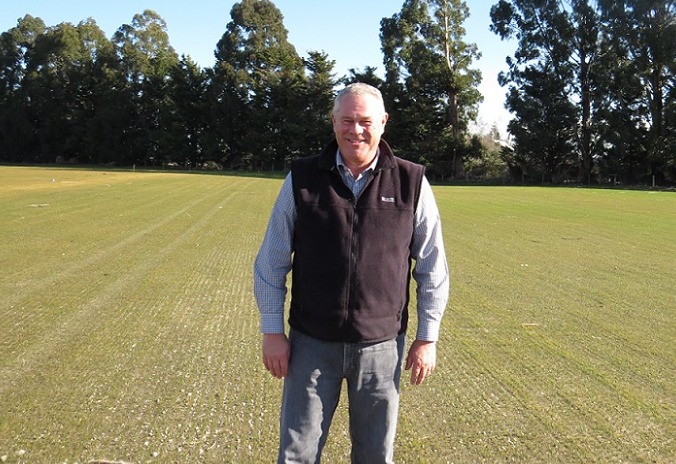 John Reid standing in a grassed sports field at Foster Park