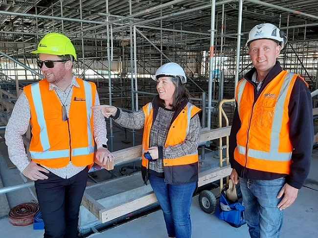 Mayor Sam Broughton, Project Manager Sandrine Carrara and Site Manager Kirill Makogon inspect the construction of the Selwyn Aquatic Centre new pool.