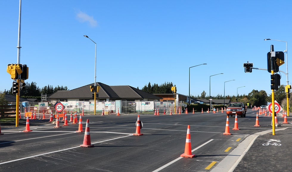 An orange 4x4 drives through the new Tennyson Lowes Road intersection