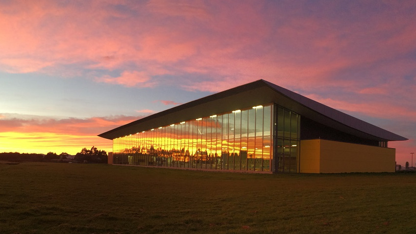 The outside of Selwyn Aquatic Centre as the sun sets