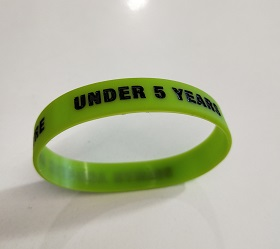 An image of the green under 5s wrist band